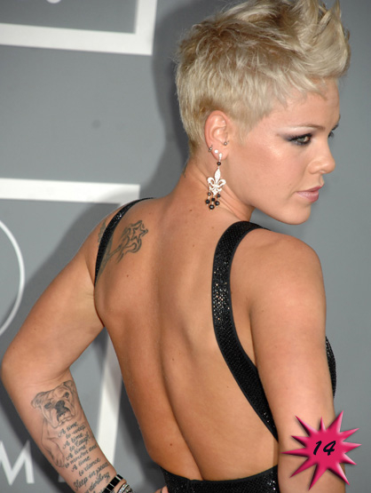 Top 15 Hottest Tattooed Women - #14 Pink: This anti-pop-star pop star has too many tattoos to even mention. The oddest of them all is the one on her left arm: a portrait of her dog Elvis, the words