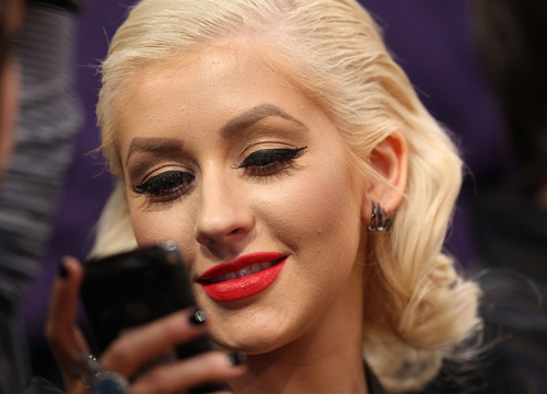 Black Berry vs. iPhone: Celebrities Weigh in - Christina Aguilera won't be using her BlackBerry to BBM to her ex anytime soon...