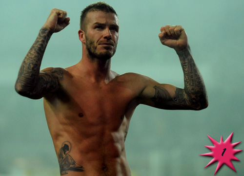 Top 15 Hottest Tattooed Men - #1<b>David Beckham</b>: Now soccer players by themselves can be pretty damn sexy, but throw in a British accent, a chiseled body and enough body art to create a minor exhibit and what do you get? Becks! David Beckham has too many tattoos to go over individually (both his front and back are literally covered), but all in all he is a masterpiece. Sometimes, an image is worth 1,000 words. Enjoy!