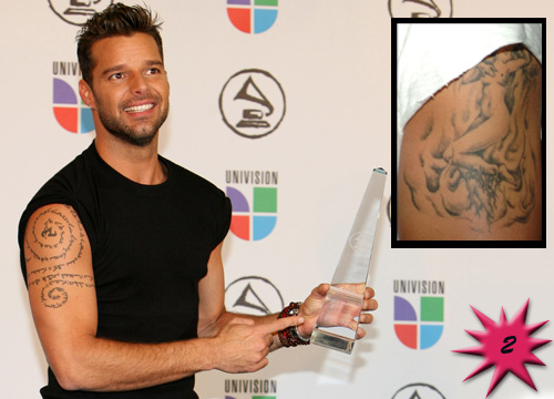 Top 15 Hottest Tattooed Men - #2<b>Ricky Martin</b>: This astro Boricua is one sexy papa! His outrageous body art makes him even sexier! Martin Sports a pinup girl on his left shoulder and an Aramaic spiral with the Lord's Prayer on his right shoulder. Ay papacito!