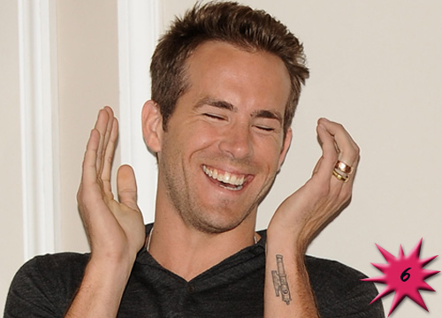 Top 15 Hottest Tattooed Men - #6<b>Ryan Reynolds</b>: This newly single superstar and mega hottie has a very sweet home-themed tattoo. He has the nine oclock gun tattooed on the side of his left forearm in honor of the gun that goes off every night at 9PM in his hometown of Vancouver, British Colombia.