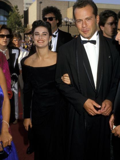 Demi Moore Through the Years - (Sept 1987) Bruce Willis and Demi Moore at the 39th Annual Emmy Awards.