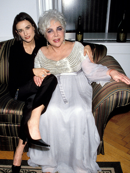 Demi Moore Through the Years - (Feb 1998) Demi Moore and Elizabeth Taylor during 17th Annual CFDA Awards Honors Elizabeth Taylor in New York City, New York, United States.