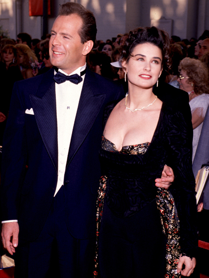 Demi Moore Through the Years - (Sept 1988) Bruce Willis & Demi Moore photographed at the Emmys.