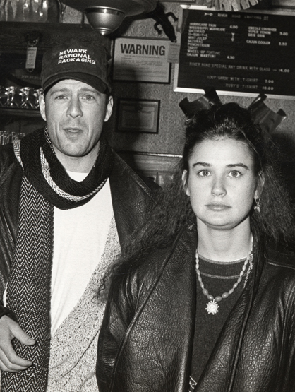Demi Moore Through the Years - (Feb 1988) Bruce Willis and Demi Moore at the Ruby's River Road Cafe in New York City.