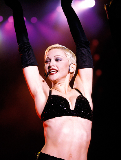 Madonna Through the Years - (Aug 1993) Madonna performing on stage - Girlie Show tour.