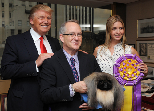 Faces and Places - 02.16.2012 Donald Trump with Ivanka Trump and his dog Malachy, at a promotional event for The Westminster Dog Show. (NYC)