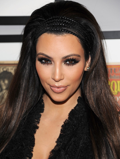 Iconic Celebrity Hair - Kim Kardashian is proof that blonds don't have more fun! Thanks to her signature raven locks, being brunette came into vogue again.