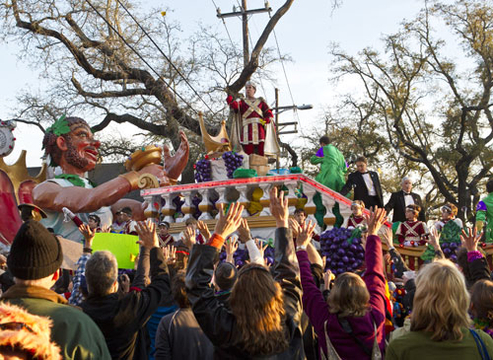 Mardi Gras 2012 - Actor and comedian Will Ferrell tosses beads and doubloons to fans as he reigns as King of Bacchus in the 2012 Krewe of Bacchus Parade in New Orleans, Louisiana.