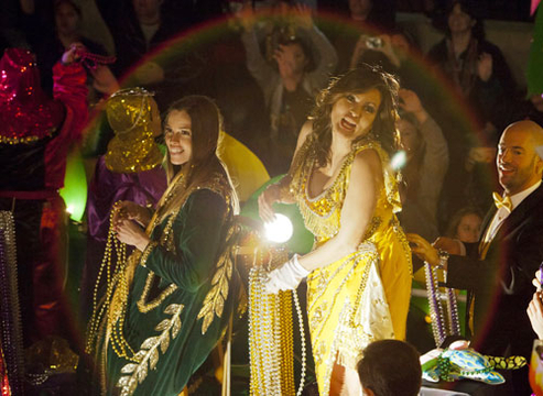 Mardi Gras 2012 - Actresses Hillary Swank and Mariska Hargitay toss beads and doubloons to fans as they ride in the 2012 Krewe of Orpheus Parade in New Orleans, Louisiana.