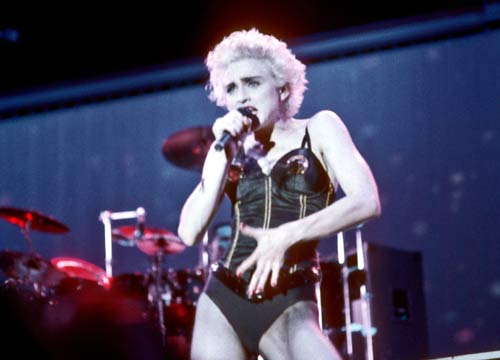 Top 10 Madonna tour costumes - Madonna performs onstage in a black bustier with lingerie on on August 6, 1987 in Los Angeles, California.