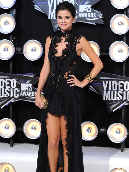 Fashion Report: 2011 MTV Video Music Awards - 2011 Video Music Awards red carpet host Selena Gomez kicked off the show in an asymmetrical Julien MacDonald black lace gown, with Brian Atwood heels and a Judith Lieber clutch.