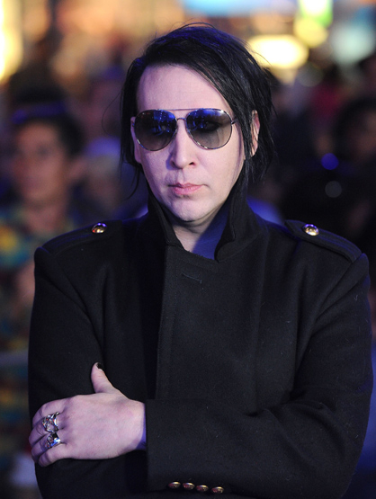 Stars Who Wore Braces - Marilyn Manson :An American musician, artist and former music journalist known for his controversial stage persona and image as the lead singer of his band.