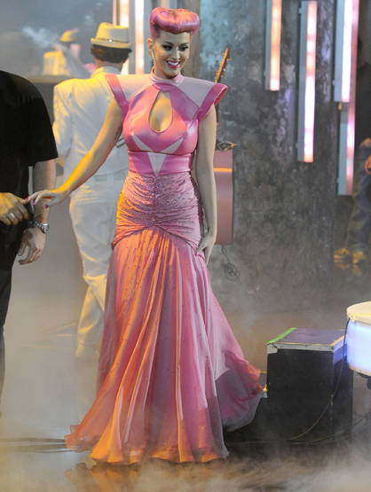 "The Best and Worst Dressed of the 2011 AMAs! - WORST Katy Perry: Despite her amazing performance, Katy disappointed again in her ""The One That Got Away"" spacey pink dress."