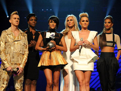 EMA 2011: Best Moments - Fashion designer Jeremy Scott and Daisy Evans, Ashley Shaw, Chelsey Reynolds, Monique Roberts, Seyi Odedere of girl group From Above onstage during the MTV Europe Music Awards 2011 live show at at the Odyssey Arena on November 6, 2011 in Belfast, Northern Ireland.