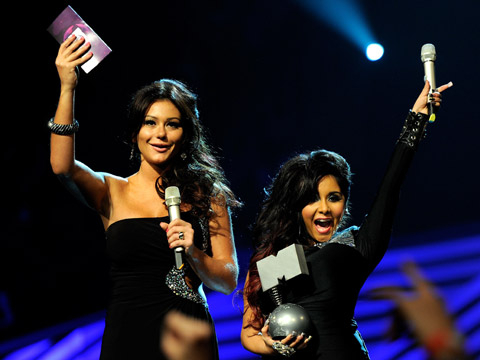 EMA 2011: Best Moments - Jenni ''JWOWW'' Farley and Nicole ''Snooki'' Polizzi of Jersey Shore onstage during the MTV Europe Music Awards 2011 live show at at the Odyssey Arena on November 6, 2011 in Belfast, Northern Ireland.