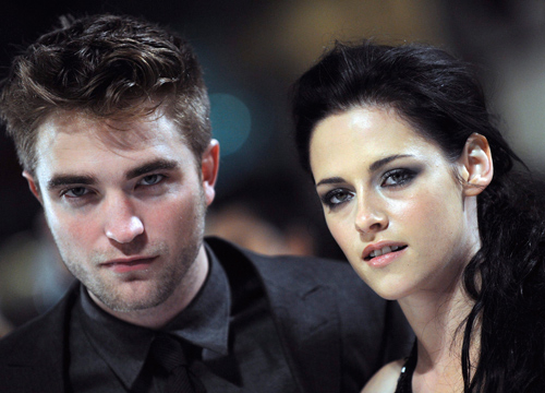 Faces and Places - 11.16.2011 Robert Pattinson (i) and Kristen Stewart (d)