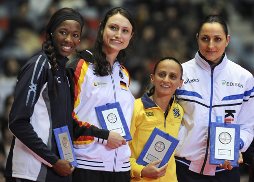 Faces and Places - 11.18.2011 Italy's Carolina Costagrande Pilar (d), the American Destinee Hooker, (i), the German vristiane Furst (2-i) and Brazil's Fabiana Oliveira (i) pose after receiving the title of best player of the tournament in Tokyo, Japan.