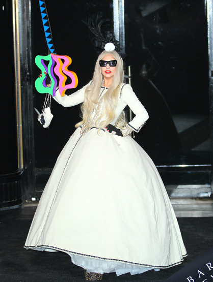 Faces and Places - 11.21.2011 Lady Gaga cuts the ribbon at the launch of her Workshop at Barneys. (NYC)