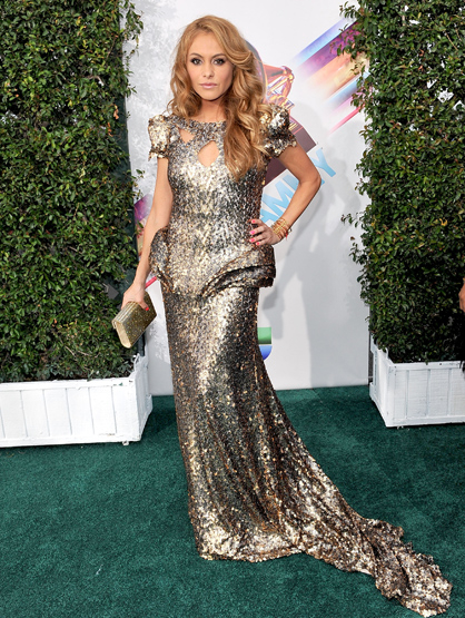 The Best and Worst Dressed at the 2011 Latin Grammy Awards - Paulina Rubio showed up in a silver gown. She was one of the most awaited appearances of the evening. I personally thought she looked kind of sloppy climbing out of the limo, but perhaps the green carpet cameras took her by surprise. I really didn't like Paulina Rubio's dress. She looked like something out of Star Trek. I liked her outfit even less during her performance, when it became a sequined bathing suit. Not too flattering.