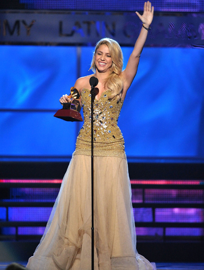 The Best and Worst Dressed at the 2011 Latin Grammy Awards - Shakira wore a beautiful gold dress, with matching gold earrings and golden locks. She was radiant and happy discussing her tribute gala when she was earlier honored as person of the year. She also wore a sparkly fitted dress with a loose peaches and cream skirt during her first performance.