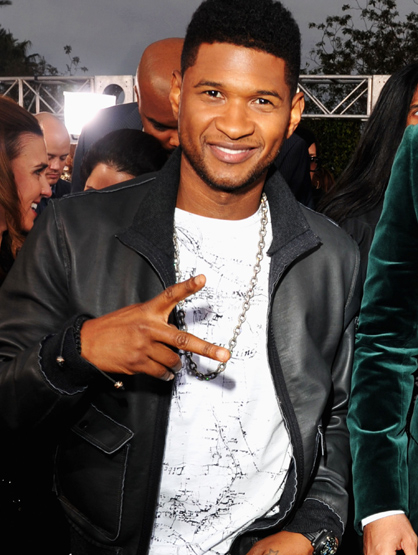The Best and Worst Dressed at the 2011 Latin Grammy Awards - Usher showed up wearing a leather jacket, along with Romeo, who wore a green velvety jacket.