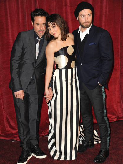 Faces and Places - 12.08.2011 Noomi Rapace with Robert Downey, Jr. and Jude Law at the premiere of