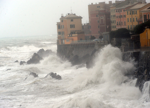 Faces and Places - 12.16.2011 Strong waves hit the coast of Genoa, Italy.