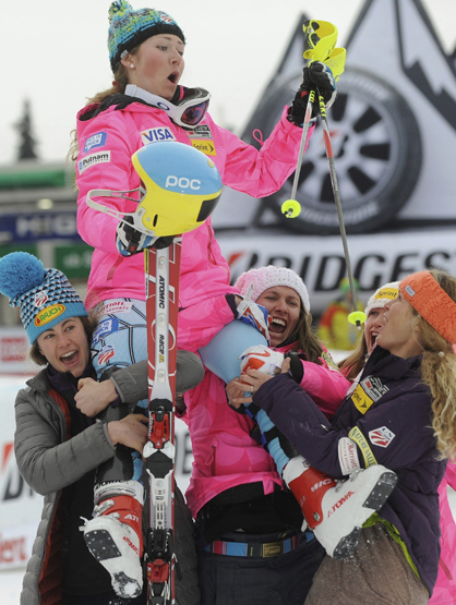 Faces and Places - 12.29.2011 U.S. skier Mikaela Shiffrin (top) celebrates with teammates after finishing third in the slalom test, valid for the World Cup downhill finals in Lienz (Austria).