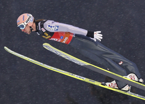 Faces and Places - 12.29.2011 Germany's Martin Koch runs his jump during the Four Hills Tournament.
