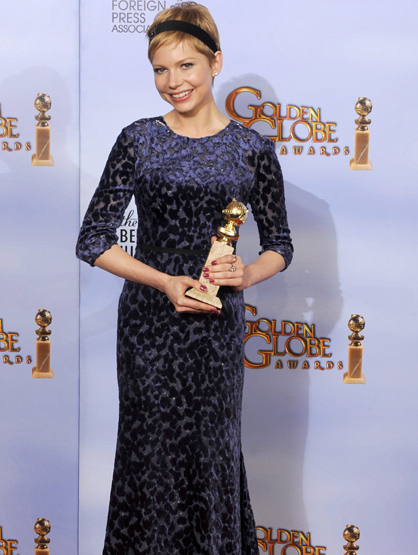 Faces and Places - 1.15.2012 Michelle Williams poses with her award for Best Actress in a Motion Picture Musical or Comedy for his performance in