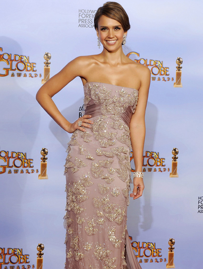 Faces and Places - 1.15.2012 Jessica Alba poses in the press room during the ceremony of the 69th edition of the Golden Globes.
