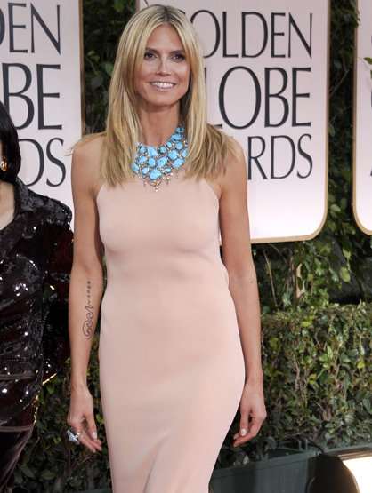 Faces and Places - 1.15.2012 Heidi Klum poses on the red carpet upon arrival at the 69th edition of the Golden Globes.