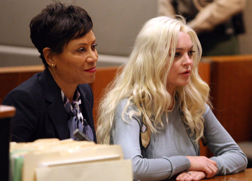 Faces and Places - 1.17.2012 Lindsay Lohan (d) and her attorney Shawn Holley (i) attend a parole hearing in court in Los Angeles.