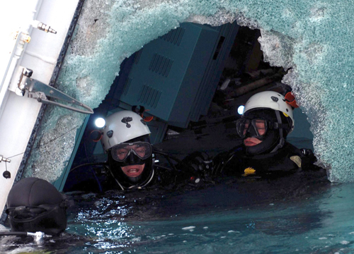 Faces and Places - 1.17.2012 Police divers try to enter the cruise ship Costa Concordia on the island of Giglio, Tuscany (Italy).