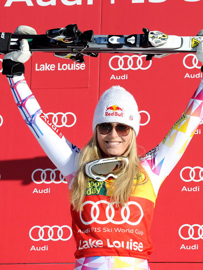Faces and Places - 12.04.2011 Lindsey Vonn celebrates on the podium her victory in Super G test, scoring for the World Cup Alpine Skiing, held in Lake Louise, Aberta, Canada.
