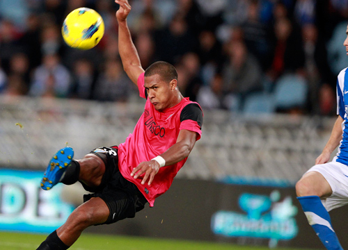 Faces and Places - 12.04.2011 Venezuelan Malaga FC striker Jose Salomon Rondon (L) tries to score against Real Sociedad during thier La Liga soccer match played at Anoeta stadium in San Sebastian, Basque Country, Spain.