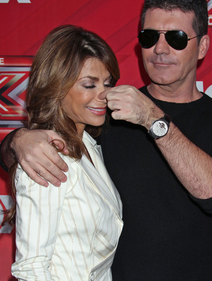 Faces and Places - 12.19.2011 Paula Abdul and Simon Cowell at The X Factor Finale Press Conference.