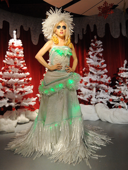 Holiday Spirit - The wax figure of US singer Lady Gaga wearing a dress made from cling film designed by Adnan Bayatt stands in a Christmas grotto at Madame Tussauds in Blackpool