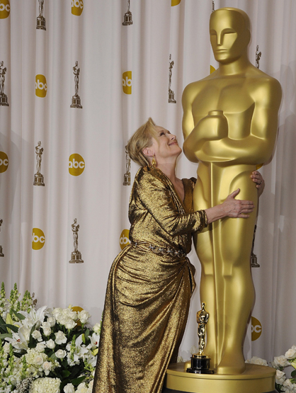 Faces and Places - 2.26.2012 Meryl Streep poses with a golden Academy Award statueduring the 84th Academy Awards.