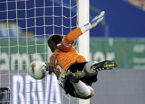 Faces and Places - 3.5.2012 Real Betis goalkeeper Fabricio, tries to stop the ball slips into the goal.