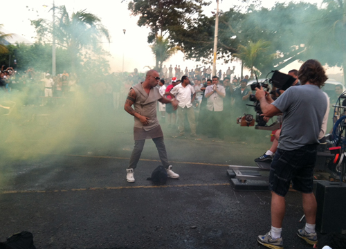 Follow the Leader: Behind the Scenes - We always knew Wisin was smokin'... and the crowd seems to love the special effect!