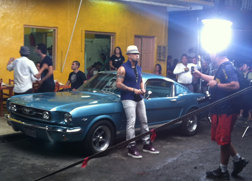 Follow the Leader: Behind the Scenes - Wisin and a muy caliente Mustang?! We'd snap a shot too.