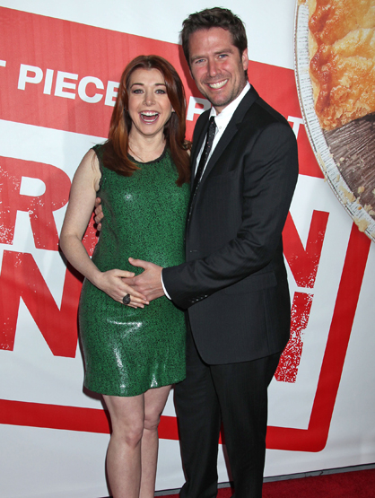 Faces and Places - 03.19.2012 Alyson Hannigan and her husband Alexis Denisof at the American Reunion, film premiere at Grauman''s Chinese Theatre in (Hollywood, CA.)