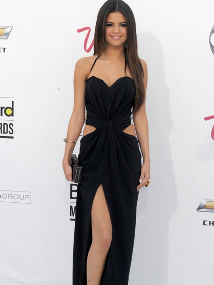 Style Evolution: Selena Gomez - May 2011: Selena shows her sexy side in this LBD at the 2011 Billboard Music Awards.