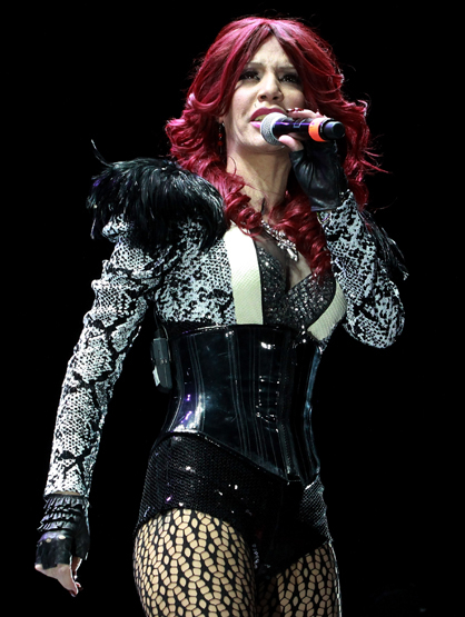 Star Style On Tour - Ivy Queen shows off her red hair with this insane black and white outfit!