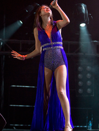 Star Style On Tour - Selena Gomez is rocking out and making this part-romper, part mullet-dress work! She is the only person who could pull that outfit off.