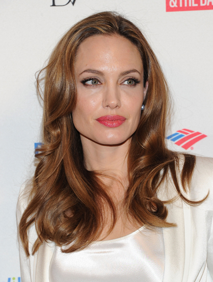 Forbes Top 25 Most Powerful Celebrities - 13. Angelina Jolie: The recently engaged beauty attracts attention wherever she goes, that's some serious magnetism. With several endorsements and residuals from previous projects, Angelina is doing very well. We can't wait for the Brangelina wedding!