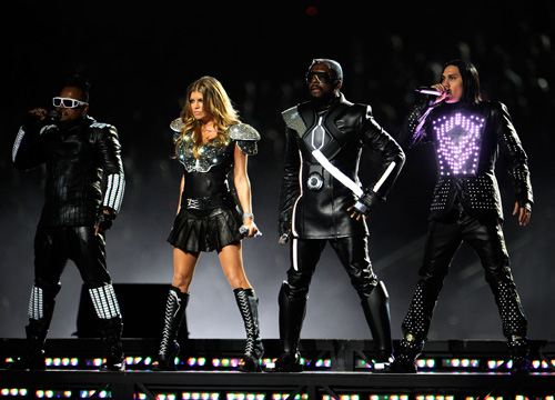 A Star-Studded Super Bowl - will.i.am, Fergie, apl.de.ap, and Taboo of The Black Eyed Peas perform during the Bridgestone Super Bowl XLV Halftime Show at Dallas Cowboys Stadium on February 6, 2011 in Arlington, Texas.