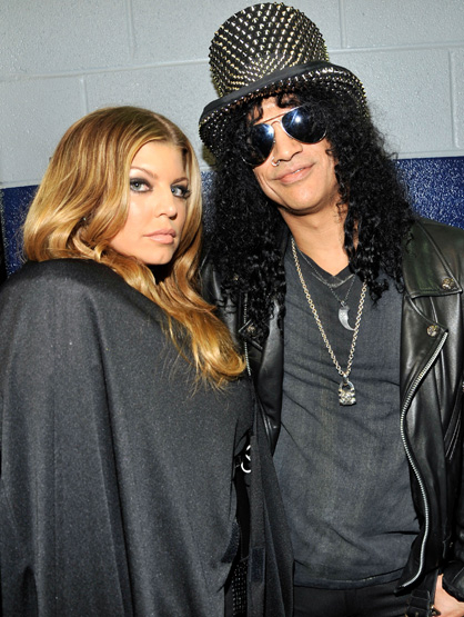 A Star-Studded Super Bowl - Fergie and Slash during the Bridgestone Super Bowl XLV Halftime Show at Dallas Cowboys Stadium on February 6, 2011 in Arlington, Texas.